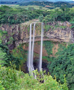 The highest waterfall on Mauritius Chamarel falls plunges more than 100 meters down against a scenic backdrop of forests and mountains.